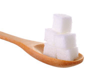 Cube sugars in wooden spoon Stock Images