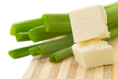 Cubed cheese with green onion Royalty Free Stock Photo