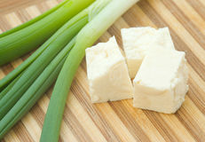 Cubed cheese with green onion Royalty Free Stock Image