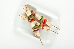 Cubed chicken kabobs plate Stock Photo