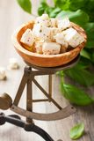Cubed feta cheese on old scales Stock Photography
