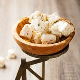 Cubed feta cheese on old scales Stock Images