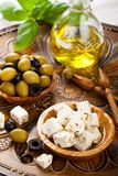 Cubed feta cheese with olives Stock Image