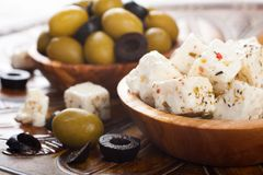 Cubed feta cheese with olives Royalty Free Stock Images