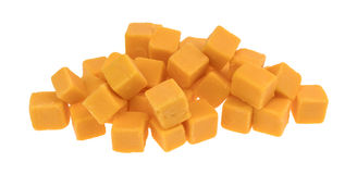 Cubed mild cheddar cheese on a white background Royalty Free Stock Photography