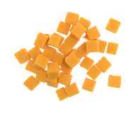 Cubed mild cheddar cheese on a white background Stock Photography