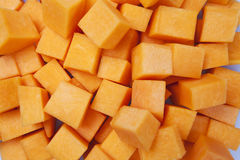 Cubed Pumpkin. Several cubes of peeled pumpkin background Stock Photography