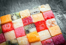Cubed tropical fruit arranged in a square Stock Photos