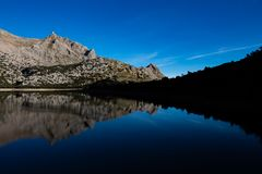 Reflections in the lake of Cúber Mallorca royalty free stock images