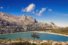 Cuber resevoir, lake, Puig Major, Tramuntana, weather station, trees,rocks, sunlight, low white clouds, turquoise water, Mallorca stock images