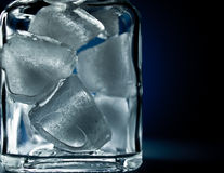 Cubes. Ice cubes in glass glass for cocktails Stock Photos