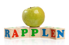 Cubes with apple Stock Image
