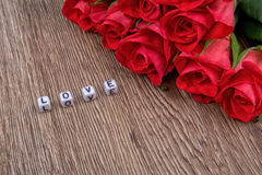 Cubes as a inscription love on a wooden background Stock Photo