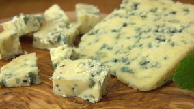 Cubes of blue Roquefort cheese stock video footage