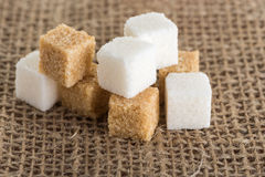 Cubes of brown and white sugar on jute bags Stock Images