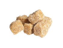 Cubes of cane sugar,  isolated on white. Lot of pieces of brown sugar, isolated on the white background Stock Photos