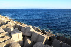 Cubes of Cement Breakwater Royalty Free Stock Photos