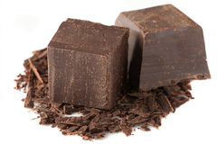 Cubes of chocolate and grated chocolate Stock Photography