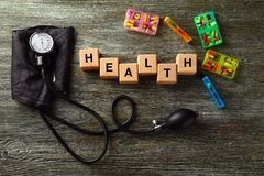 Cubes composed word HEALTH on wooden table royalty free stock photo