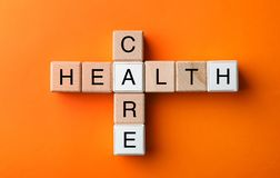 Cubes composed words HEALTH CARE on color background royalty free stock photos