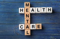 Cubes composed words MENTAL HEALTH CARE on color wooden table stock images