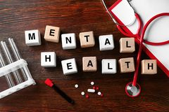 Cubes composed words MENTAL HEALTH on wooden table stock photography
