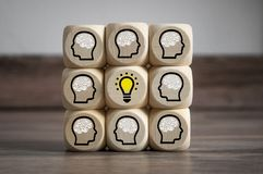 Cubes Dices with brainstorming and light bulb teamwork royalty free stock image