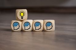 Cubes Dice with brainstorming and light bulb teamwork royalty free stock photography