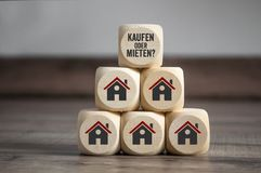 Cubes dice with buy or rent and house icons stock photo