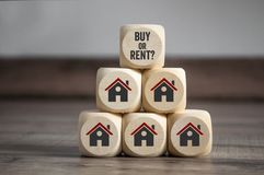 Cubes dice with buy or rent and house icons stock photography