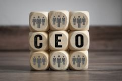 Cubes and dice with CEO and employees stock photos