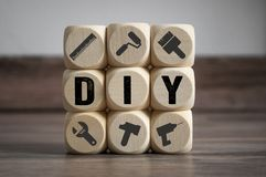 Cubes and dice with do it yourself DIY stock image