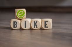 Cubes dice with e-bike royalty free stock photo