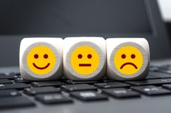 Emoticons on a keyboard, happy, unhappy stock photo