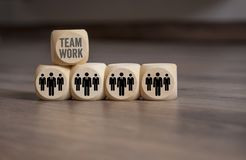 Cubes with employees and teamwork stock image