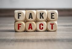 Cubes and Dices Fake News Fake Post Fact. Cubes and Dice Fake News Fake Post Fact stock image