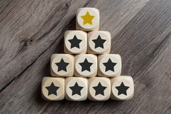 Cubes and dice with golden star on top of a pyramide royalty free stock photo