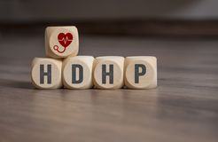 Cubes and dice with HDHP high-deductible health plan stock photos