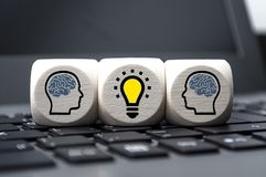 Cubes dice with heads and brains royalty free stock photo