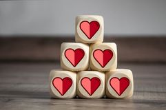 Cubes and dice with illustrated hearts royalty free stock images