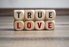 Cubes and dice with illustrated hearts stock photography