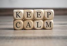 Cubes dice with keep calm stock photos
