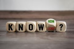 Cubes dice with knowledge and knowhow royalty free stock photos