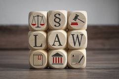 Cubes dice with law symbols and law royalty free stock photo