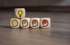 Cubes Dice with light bulb and brains stock images