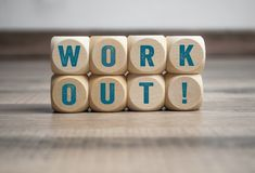 Cubes and dice with message workout on wooden background