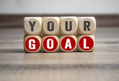 Cubes and dice with message your goal royalty free stock photos