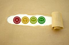 Cubes dice and paper work with rating emoticons for customer support royalty free stock photos