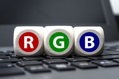 Cubes dice with RGB on laptop keyboard royalty free stock photo