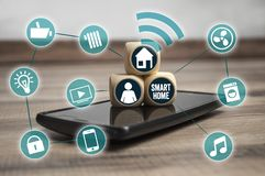 Cubes and dice with smartphone and network smart home icons stock photos